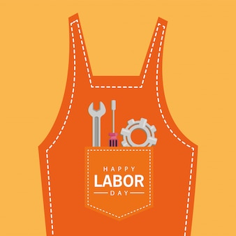 Happy labor day celebration with tools in overalls pocket
