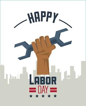 都市と手の保持ツールレンチのシルエットと幸せな労働日