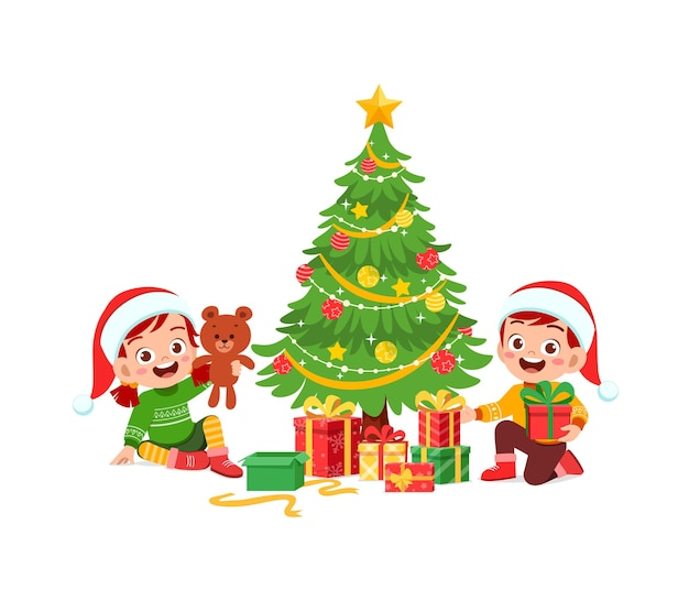 Счастливый маленький мальчик и девочка с подарком на рождество
