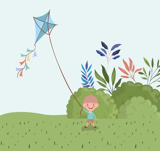 풍경에 연을 비행하는 행복 한 소년
