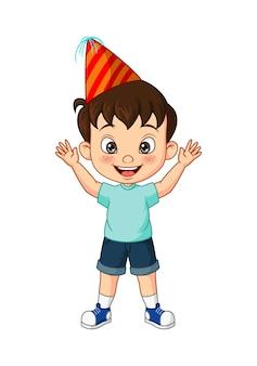 Happy little boy wearing a party hat