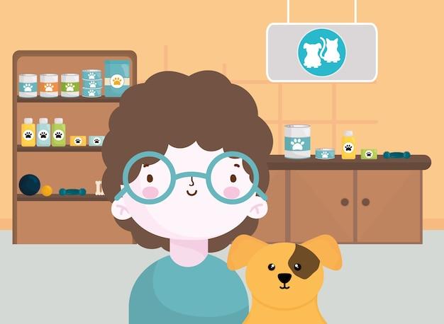 Счастливый маленький мальчик с собакой в ветеринарной комнате