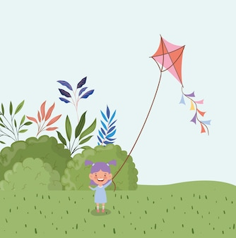 Happy little girl flying kite in the field landscape