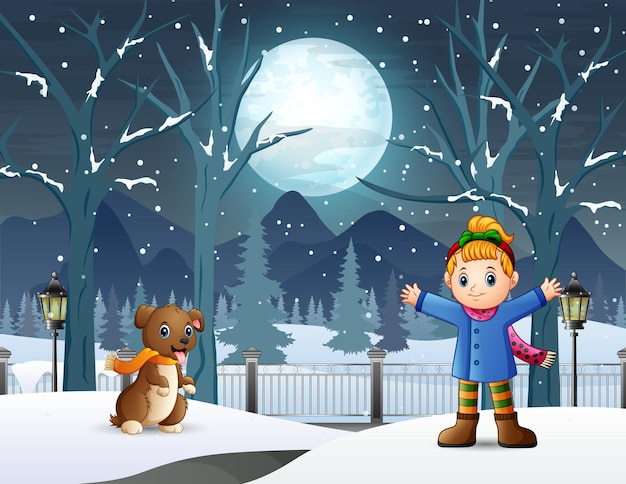 Happy little girl playing with her pet in winter night