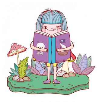Happy little girl reading book in the field