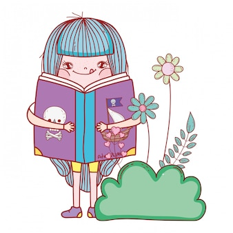 Happy little girl reading book in the garden