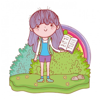 Happy little girl reading book with rainbow