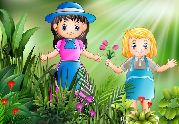 Happy little girls picking a flowers in the garden