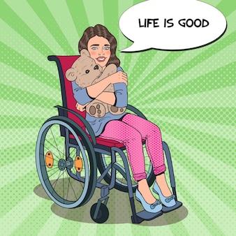 Happy little handicapped girl in wheelchair