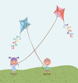 Happy little kids flying kites in the field landscape