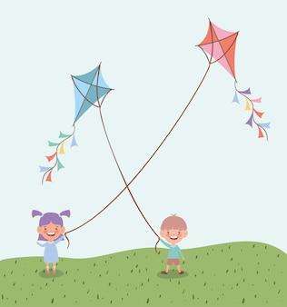 Счастливые маленькие дети летающих змеев в поле пейзаж