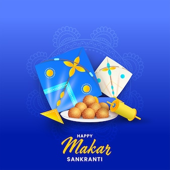 Happy makar sankranti concept with glossy kites, string spools and indian sweet (ladoo)