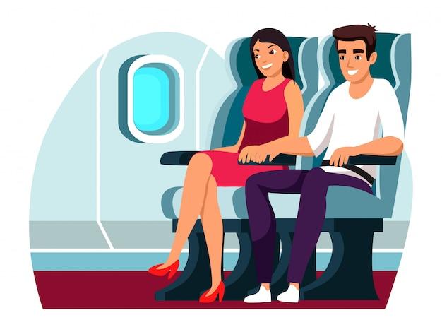 幸せな男と女の飛行機のキャビンを飛んで