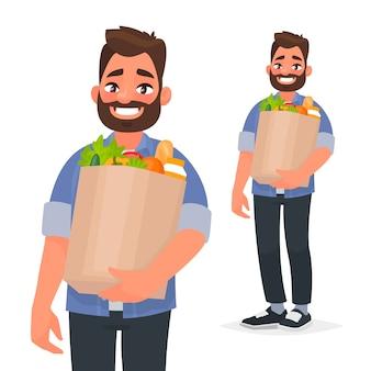 Счастливый человек, держа в руках продуктовую сумку. покупатель в супермаркете.