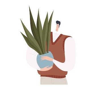 幸せな男は植物を持っています。白い背景で隔離。