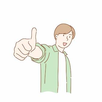 Счастливый человек показывая жест с подъемами большого пальца руки.