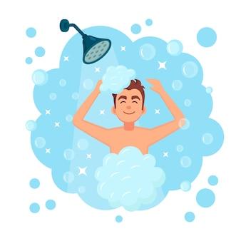 浴室でシャワーを浴びている幸せな男。