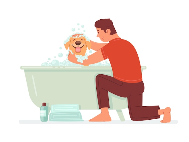 Happy man washes the dog in the bathroom the guy takes care of his pet hygiene home animal