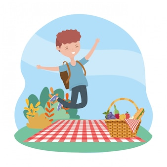 Happy man with backpack and basket blanket picnic nature