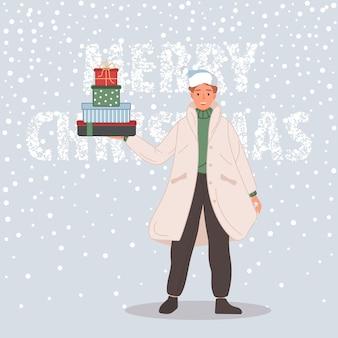 크리스마스 선물을 가진 행복한 남자 산타 모자를 쓰고 있는 남성 메리 크리스마스 컨셉