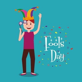 Happy man with jester hat holding glasses fools day