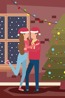 Happy merry christmas couple celebrating with pine tree