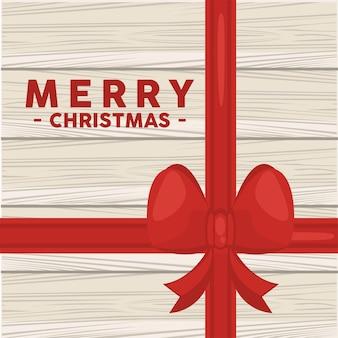 나무 배경에서 boow와 함께 행복 한 메리 크리스마스 글자 카드