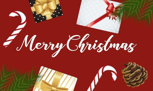 甘い杖とギフトでハッピーメリークリスマスのレタリング