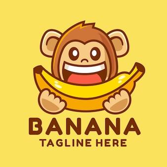 バナナを食べる幸せな猿のロゴのデザイン