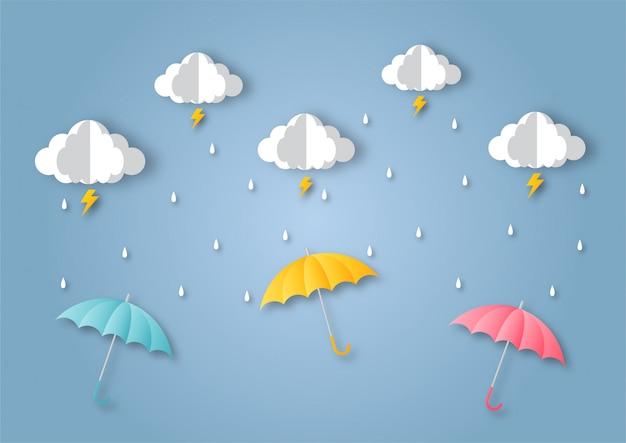 幸せなモンスーンシーズンの背景。雨の中の虹。紙のアートスタイル。