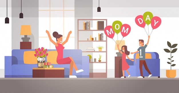 Happy mother day, children greeing mom in living room spring holiday