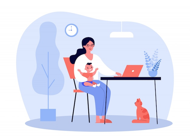 Happy mother holding baby and working online at home