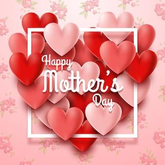 心と花の背景を持つ幸せな母の日