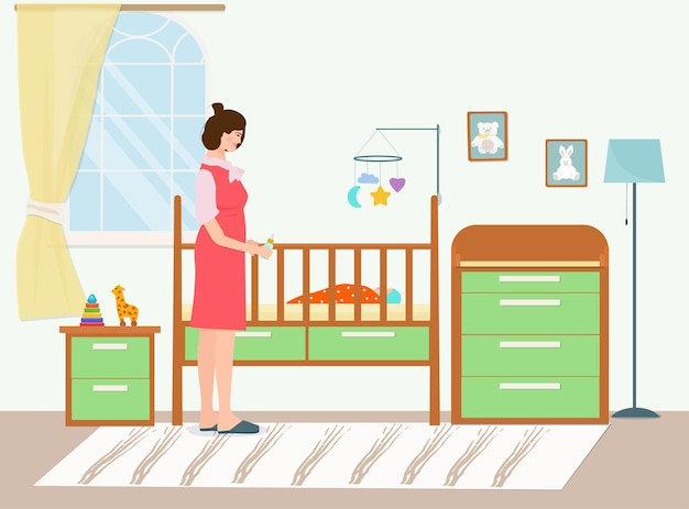 A happy mother with a feeding bottle at the crib with a newborn baby.  the interior of the children's bedroom.