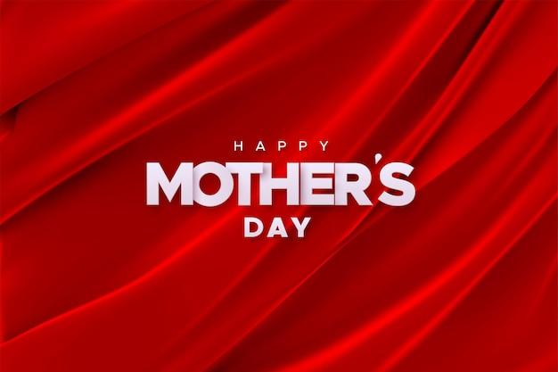 赤いベルベット生地の背景に幸せな母の日サイン