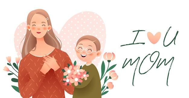 해피 어머니의 날. 소년은 어머니에게 꽃다발을 준다.