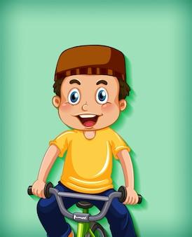 自転車に乗って幸せなイスラム教徒の少年