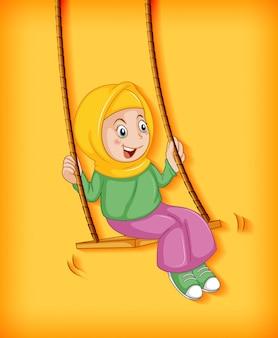 Happy muslim girl sit on swing
