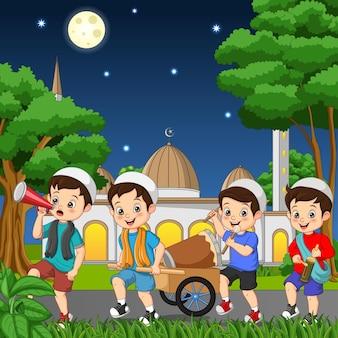 Happy muslim kid celebrating eid mubarak with hitting drum kentongan and megaphone
