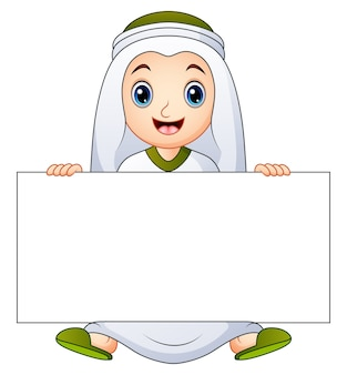 Happy muslim kid holding blank sign