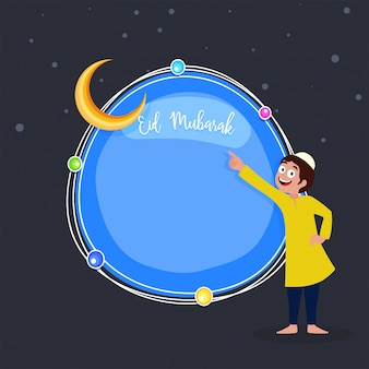 Happy muslim kid pointing towards moon, blessed festival eid mubarak concept.
