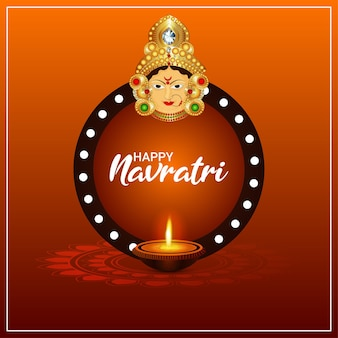 Happy navratri celebration greeting card with illustration of goddess durga face and diya