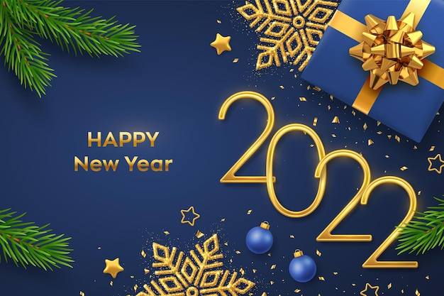 Happy new 2022 year. golden metallic numbers 2022 with gift box, shining snowflake, pine branches, stars, balls and confetti on blue background. new year greeting card or banner template. vector.