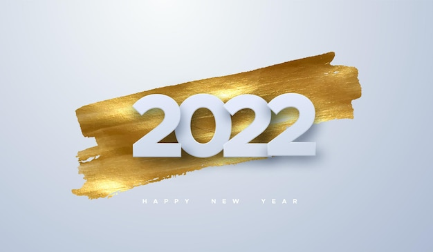 Happy new 2022 year white paper sign on golden paint stain background
