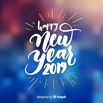 Happy new year 2019 composition with white lettering over blurry background