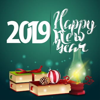 Happy new year 2019 - green new year greeting card with books and antique lamp