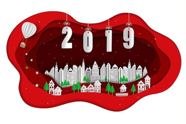 赤い背景の背景に白い都市とハッピーニューイヤー2019