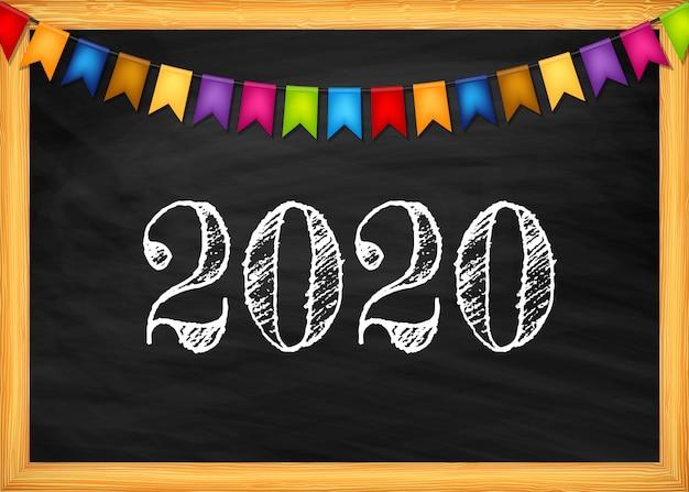 Happy new year 2020 text on blackboard.