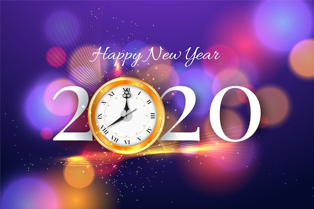 Happy new year 2020 with clock and bokeh background