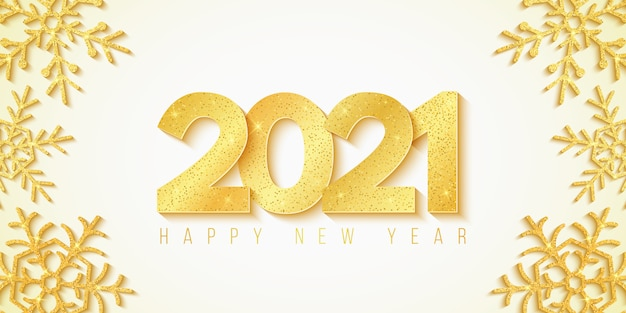 Happy new year 2021. festive background and golden snowflakes with glitter. golden 3d luxurious numbers.